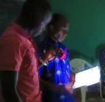 pastor leads a Christian meeting by flashlight 1 23 2015