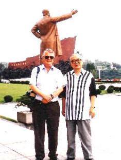 Dan Wooding and South Korean pastor David Cho by statue of Kim Il Sung in North Korea
