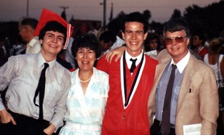Peter with family at his graduation