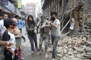 Man being rescued after Nepal Earthquake