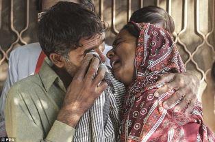 Relatives of the Christian couple burned alive EPA