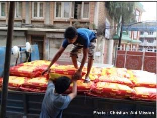 Relief goods being loaded onto a truck Christian Aid Mission