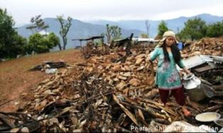Survivor picking her way through the rubble of Nepal earthquake Christian Aid Mission