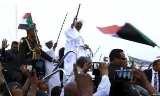 Bashir waving to supporters