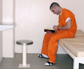 Reading a Bible in jail Brother Ned