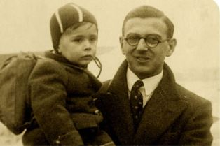 Sir Nicholas Winton with a child he rescued Press Association