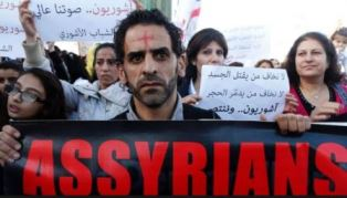 Assyrians hold banners