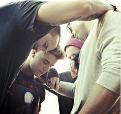 Justin praying with friends Mark Ellis
