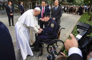 Pope greets policeman at Ground Zero