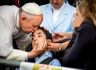 Pope kisses young man in Philadelpia