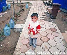 Refugee boy Christian Aid Mission