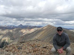 Coming off the summit of 14092 Snowmass Mountain in the Maroon Bells near Aspen