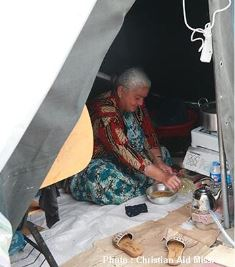 Displaced woman in tent in Erbil