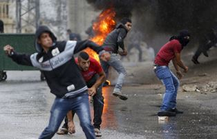 Palestinian youth hurl stones
