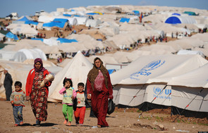 Refugees in a makeshift camp