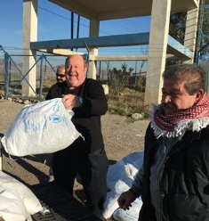 Smaller. Bob Armstrong unloads food supplies