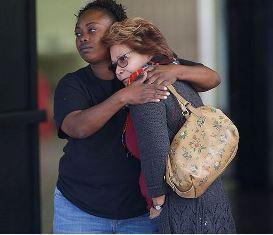 Two women comfort each other in San Bernardino