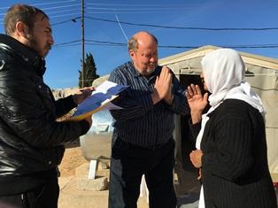 smaller Bob Armstrong prayers with Yazidi widow