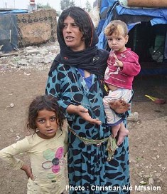 smaller family in refugee camp Christian Aid