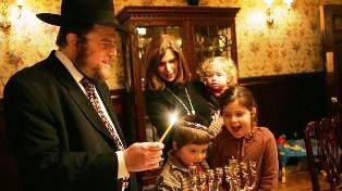 smaller lighting the Hanukkah