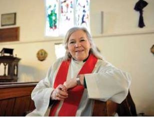 Cindy Kent as the priest