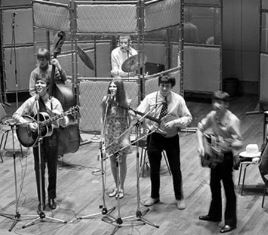 Cliff Richard with The Settlers in a studio