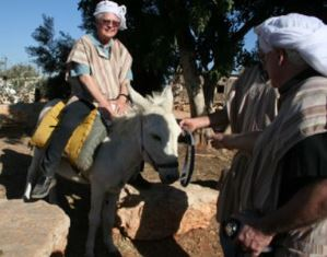 Dan Wooding rides a donkey in Israel