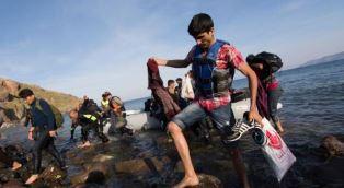 Migrants arriving is Lesvos Adrian Hawkes