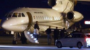 Plane arrives with Saeed and others