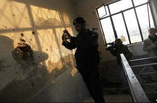 Soldier takes picture of damage at Pakistan University