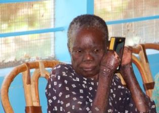 Tanzanian lady with leprosy with her Talking Bible