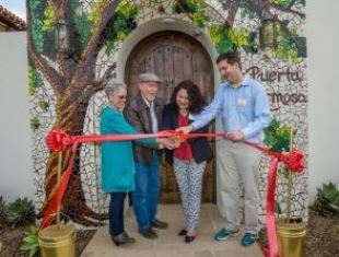Cutting red ribbon at opening ceremony in Baja