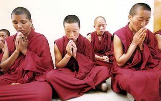Tibetan monks at prayer