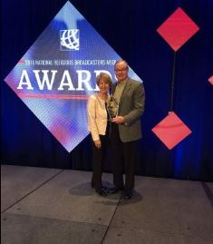 smaller Perry Atkinson with his wife receiving the NRB Award