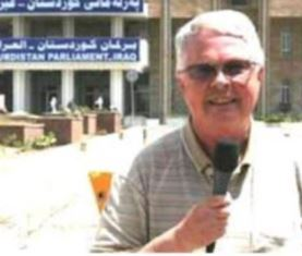 Dan Wooding reporting for ANS from outside the Kurdistan Parliament in Iraq