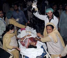 Paramedics treat a victim in Lahore bomb blast