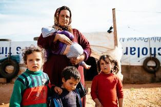 Syrian refugee mother and children