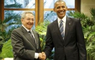 smaller Barack Obama shakes hands with Raul Castro