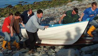 Bringing boat ashore Ted Harrison