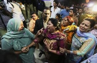 Realatives outside the Lahore hospital where people are being treated