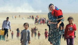 Yazidi woman with children fleeing from ISIS