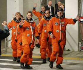 smaller Dutton as part of the crew for space shuttle Discovery