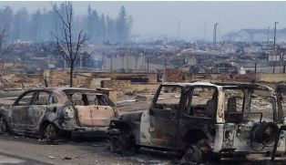 burnt cars in Fort MacMurray