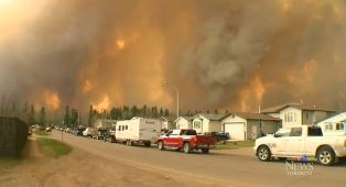 smaller Cars escaping from Fort MacMurray fire