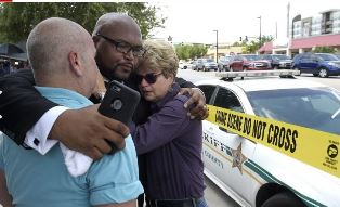 Church pastor hugs others in Orlando