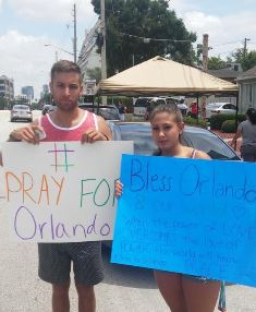 Couple hold signs after Orlando shooting