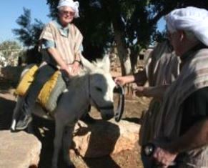 Dan Wooding riding donkey in Israel