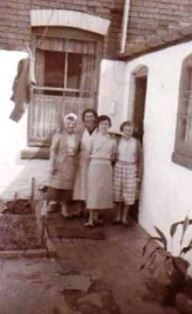 Family in back yard at 90 Sutton Street