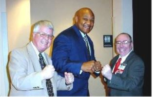 smaller Dan Wooding and Michael Ireland with George Foreman
