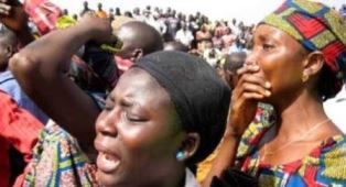 smaller Grieving women after an attack by Fulani herdsmen